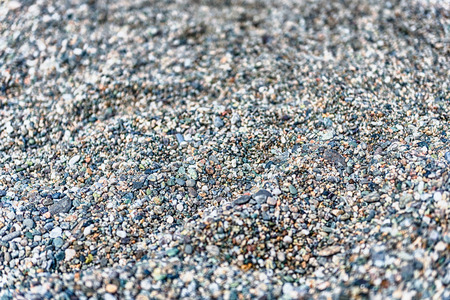 Top view of detailed sand texture on a sandy beach, may be used as background