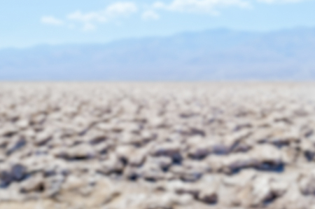 Defocused background of Devils Golf Course in Death Valley, California. Intentionally blurred post production for bokeh effect