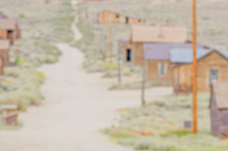 Defocused background with Main Street in Old Wild West Town. Intentionally blurred post production for bokeh effect