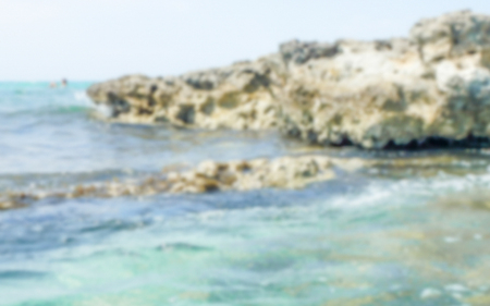 Defocused background of Baia dei Turchi beach in Salento, Italy. Intentionally blurred post production for bokeh effect