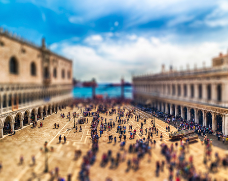 Panoramic aerial view of tourists visiting the iconic Piazza San Marco (St. Marks Square), Venice, Italy. Tilt-shift effect applied