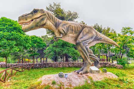 SAN MARCO IN LAMIS, ITALY - JUNE 9: Tyrannosaurus Rex dinosaur, aka t-rex, featured in the Dino Park in San Marco in Lamis, small town in southern Italy, June 9, 2018