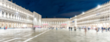Defocused background of St. Marks Square at night, Venice, Italy. Intentionally blurred post production for bokeh effect