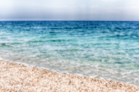 Defocused background of a scenic beach on the thyrrenian coastline in Calabria, Italy. Intentionally blurred post production for bokeh effect