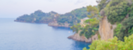 Defocused background of Portofino in Liguria, Italy. Intentionally blurred post production for bokeh effect Фото со стока