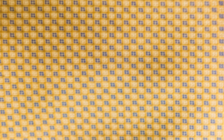 Defocused background of a necktie texture. Intentionally blurred post production for bokeh effect