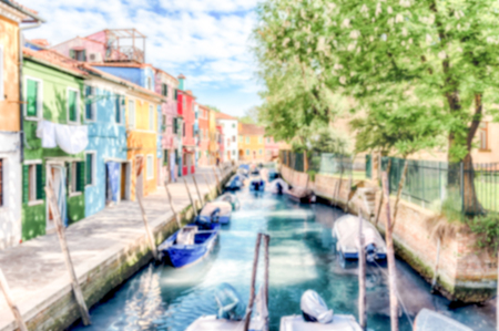 Defocused background of colorful houses along the canal on the island of Burano, Venice, Italy. Intentionally blurred for bokeh effect Stockfoto