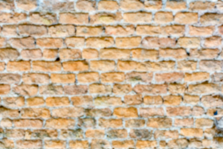 Defocused background of stone brick wall texture with copy space. Intentionally blurred post production for bokeh effect Stockfoto