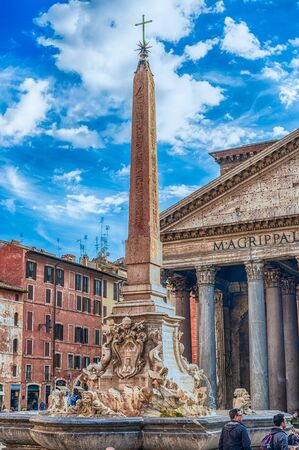 ROME - NOVEMBER 18: Fountain and obelisk in Piazza della Rotonda in front of the Pantheon, iconic landmark and sightseeing in Rome, Italy, November 18, 2018 Редакционное