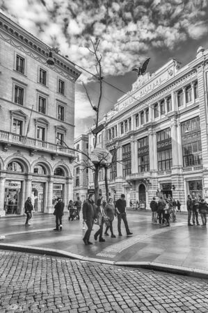 ROME - NOVEMBER 18: An ordinary day in the famous Via Condotti, busy and fashionable street of Rome, Italy, as of November 18, 2018. The street contains the greatest number of Rome-based Italian fashion retailers, such as Gucci, Bulgari, Dior among many o
