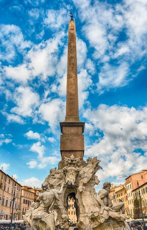 ROME - NOVEMBER 18:  Obelisk and Fountain of the Four Rivers, iconic landmark designed in 1651 by Bernini, located in the famous Piazza Navona, Rome, Italy, November 18, 2018