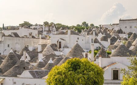 Scenic panoramic view of Alberobello town and its typical trulli buildings, Apulia, Italy