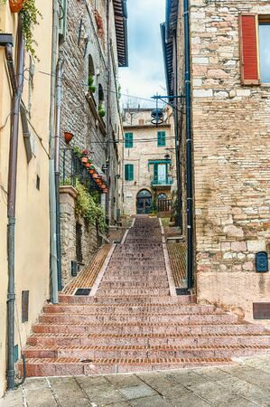 Walking in the picturesque and ancient streets of Assisi, one of the most beautiful medieval towns in central Italy Stock fotó