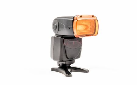 Oblique view of a black unbranded external flash unit for DSLR camera with warming diffuser applied Фото со стока