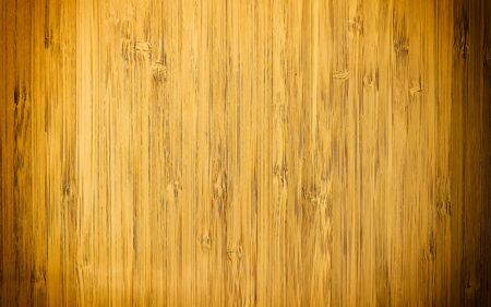 Background of a wooden brown texture with vignette effect Фото со стока