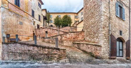 Panoramic view of a scenic ramp in the picturesque streets of Gubbio, one of the most beautiful medieval towns in central Italy Stock fotó