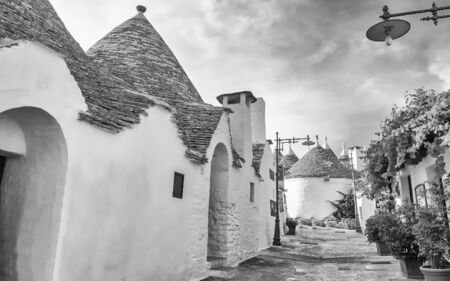 Typical trulli buildings with conical roofs in Alberobello, Apulia, Italy