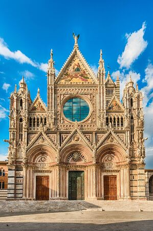 View of the facade of the gothic Cathedral of Siena, Tuscany, Italy. Completed in 1348, the church is dedicated to the Assumption of Mary and it is one of the most visited sightseeing of Siena Фото со стока