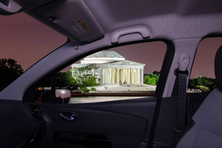 Looking through a car window with view of the Jefferson Memorial at night in Washington DC, USA