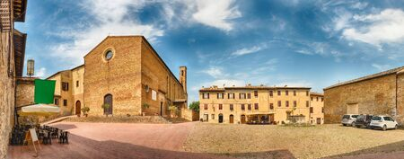 Panoramic view with the Church of SantAgostino, landmark in the medieval town of San Gimignano, Tuscany, Italy