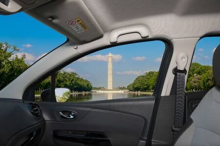 Looking through a car window with view of the Washington Monument and Reflecting Pool, Washington DC, USA