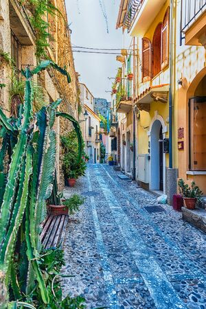 Picturesque streets and alleys in the seaside village of Chianalea, fraction of Scilla, Calabria, Italy Фото со стока