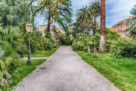 Scenic trail surrounded by nature inside a public park in the city centre of Rome, Italy Фото со стока