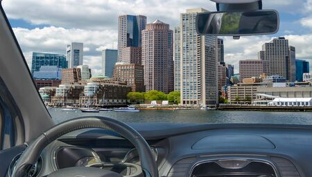 Looking through a car windshield with view of the Boston skyline, USA