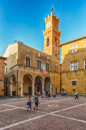 PIENZA, ITALY - JUNE 23: View of the Town Hall of Pienza, Tuscany, Italy on June 23, 2019. It's located in Piazza Pio II, the pope whose name was given to the city: Pienza means in fact