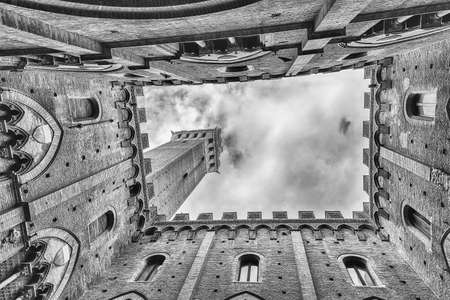 Scenic view from the bottom at the patio of Palazzo Pubblico, major landmark in Siena, Italy Stock fotó