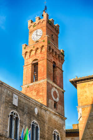 """Clocktower of the Town Hall of Pienza, Tuscany, Italy. It is located in Piazza Pio II, the pope whose name was given to the city: Pienza means in fact """"City of Pius"""""""
