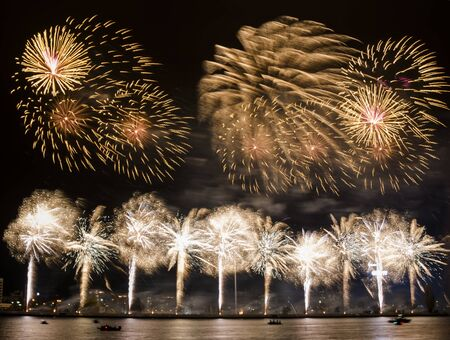 Gorgeous fire show. Exciting golden firework splashes exploding in the night. Banco de Imagens - 146356651