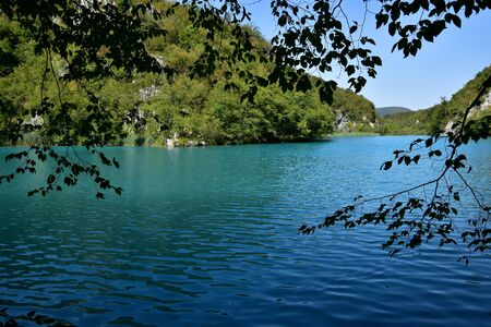Turquoise relaxing water and tranquil atmosphere in Plitvice Lakes, Croatia.