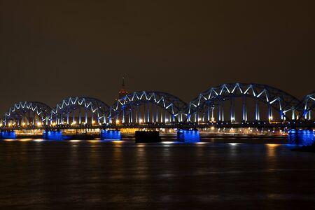 Bridge through the river with blue led lights. Banco de Imagens