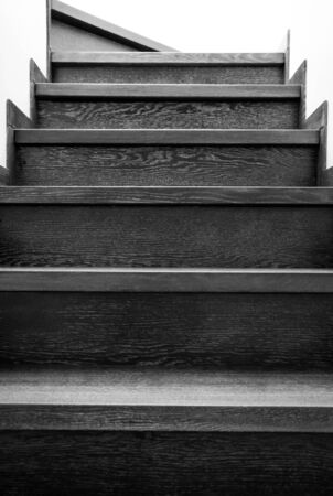 Wooden stairs in the house. Monochrome stairs up. Wooden interior elements. Banco de Imagens - 147354764