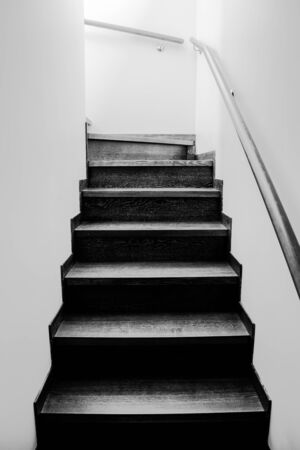 Wooden stairs in the house. Monochrome stairs up. Wooden interior elements. Banco de Imagens - 147354766
