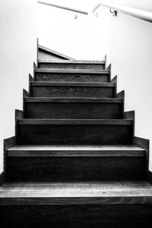 Wooden stairs in the house. Monochrome stairs up. Wooden interior elements. Banco de Imagens