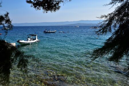 Seascape view with small boats in Croatia, Bol Island.