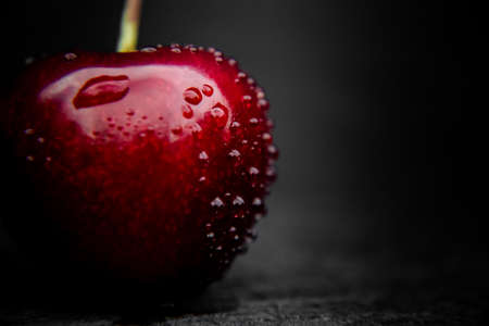 Sweet cherry berry with water drops on it. Banco de Imagens - 151161864