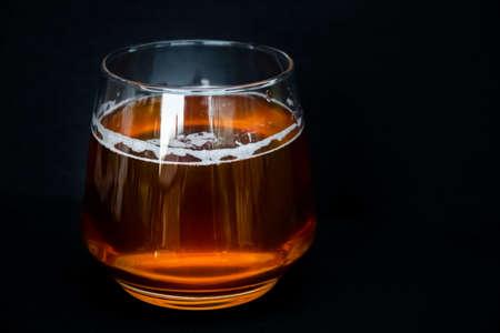 Glass of delicious beer. Light alcohol drink. Dark background. Banco de Imagens