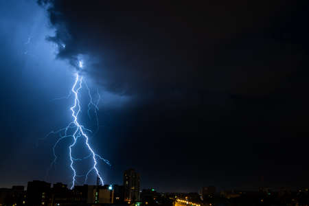 Bright flash of powerful lightning in the city at nighttime. Banco de Imagens - 151748025