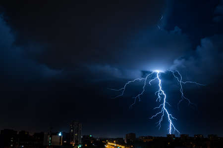 Bright flash of powerful lightning in the city at nighttime. Banco de Imagens - 151748267