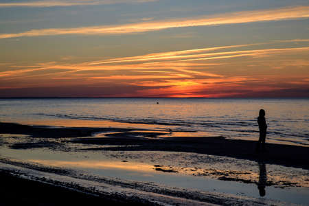 Warm breathtaking summer sunset on the Baltic sea with calm and relaxing water. Banco de Imagens