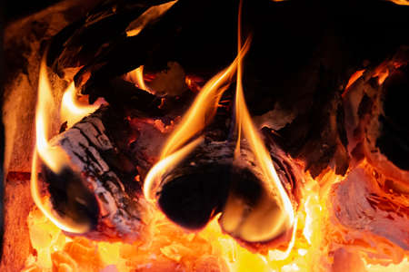 Closeup photo of blazing and warming fire in the stove. Stock Photo