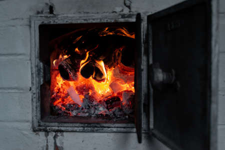 Blazing and warming fire in the stove.