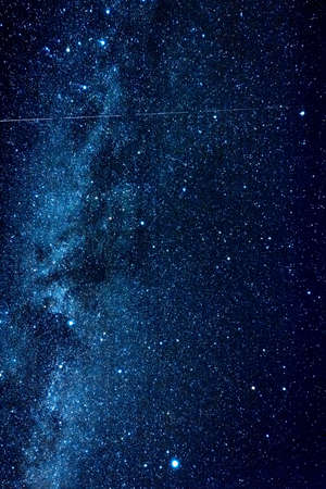 Vertical photo of amazing clear night sky with milky way and huge amount of stars.