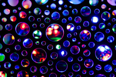 Background of abstract circles illuminated with multicoloured flashlight.