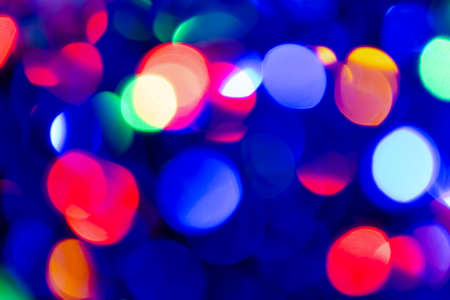 Abstract background with colourful blurred bright circles.