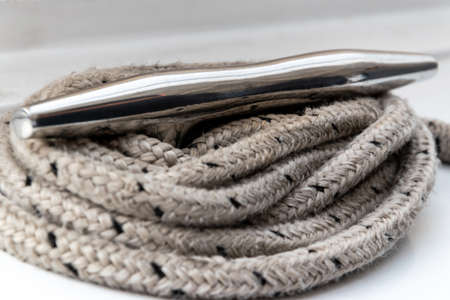 Close up of secured twisted rope on the boat.