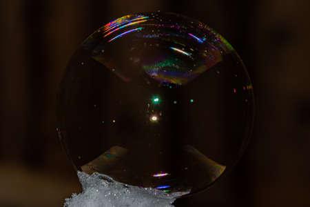 Close up of round fragile soap bubble with rainbow colours. Banco de Imagens